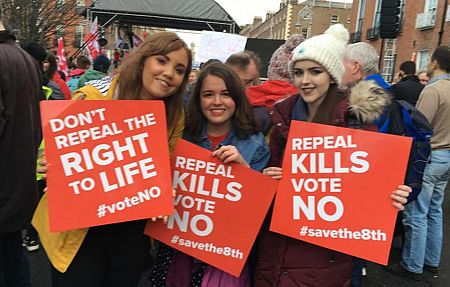 Irish women holding pro-life signs